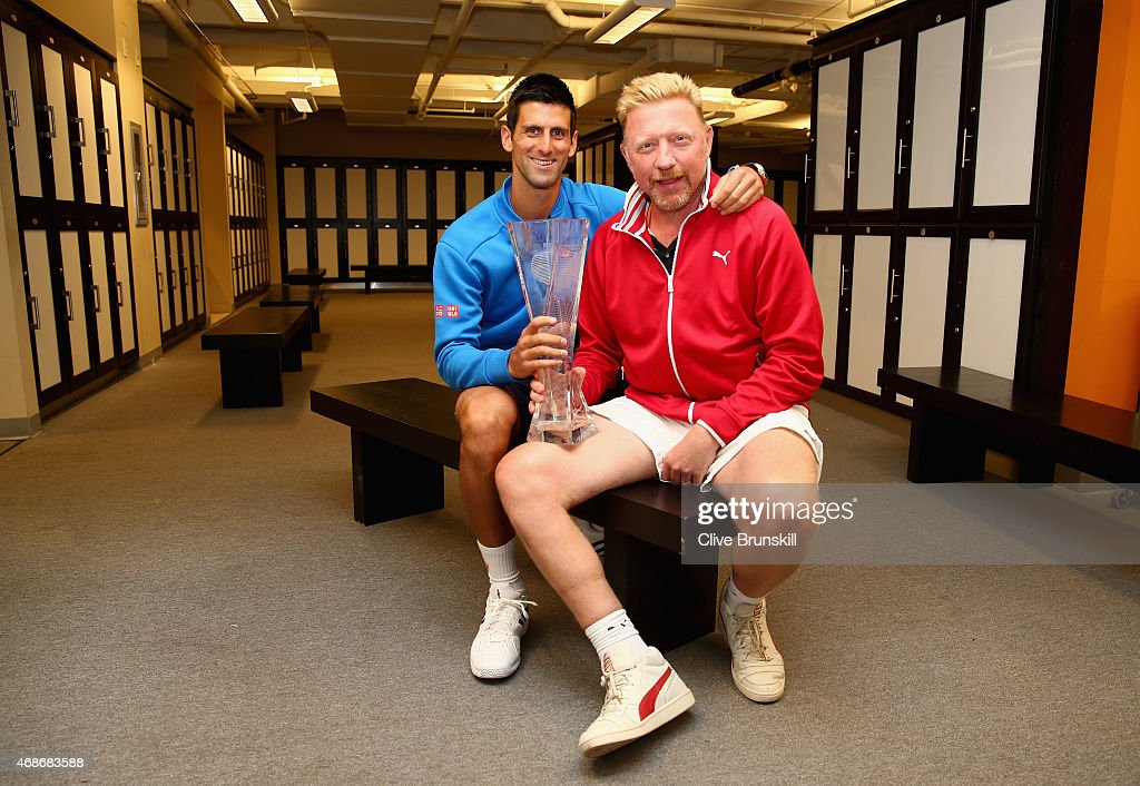 <a gi-track='captionPersonalityLinkClicked' href=/galleries/search?phrase=Novak+Djokovic&family=editorial&specificpeople=588315 ng-click='$event.stopPropagation()'>Novak Djokovic</a> of Serbia poses for a locker room photograph with his coach <a gi-track='captionPersonalityLinkClicked' href=/galleries/search?phrase=Boris+Becker&family=editorial&specificpeople=67204 ng-click='$event.stopPropagation()'>Boris Becker</a> and the Butch Bucholz trophy after his three set victory against Andy Murray of Great Britain in the mens final during the Miami Open Presented by Itau at Crandon Park Tennis Center on April 5, 2015 in Key Biscayne, Florida.