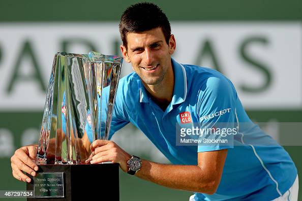 Novak Djokovic of Serbia poses for photographers after defeating Roger Federer of Switzerland during the final on day fourteen of the BNP Paribas...