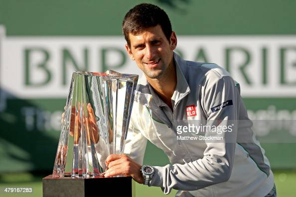 Novak Djokovic of Serbia poses for photographers after defeating Roger Federer of Switzerland during the final of the BNP Parabas Open at the Indian...