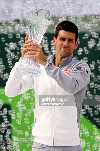 Novak Djokovic of Serbia poses for photographers with the Butch Buchholz Torphy after defeating Rafael nadal of Spain during the final of the Sony...