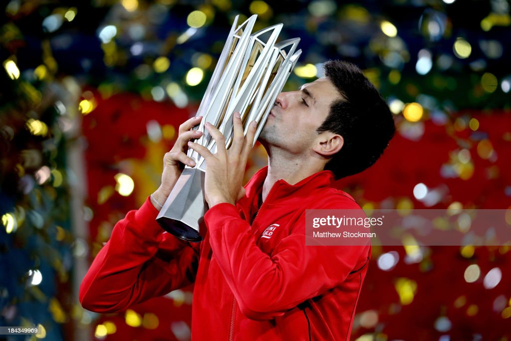 <a gi-track='captionPersonalityLinkClicked' href=/galleries/search?phrase=Novak+Djokovic&family=editorial&specificpeople=588315 ng-click='$event.stopPropagation()'>Novak Djokovic</a> of Serbia poses for photographers with the winner's trophy after defeating Juan Martin Del Potro of Argentina during the final of the Shanghai Rolex Masters at the Qi Zhong Tennis Center on October 13, 2013 in Shanghai, China.