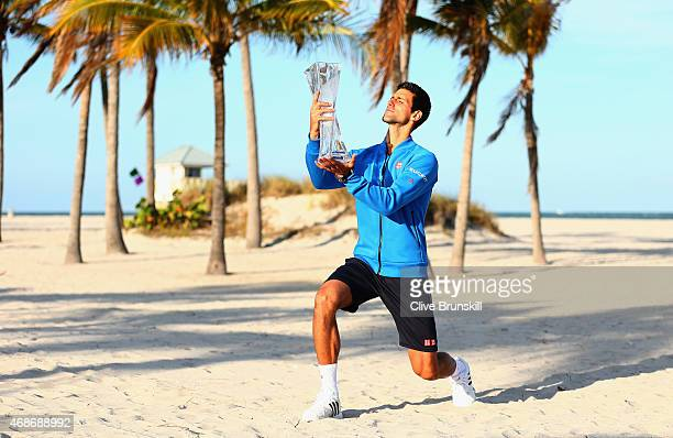 Novak Djokovic of Serbia poses on Crandon Park beach with the Butch Buchholz trophy after his three set victory against Andy Murray of Great Britain...