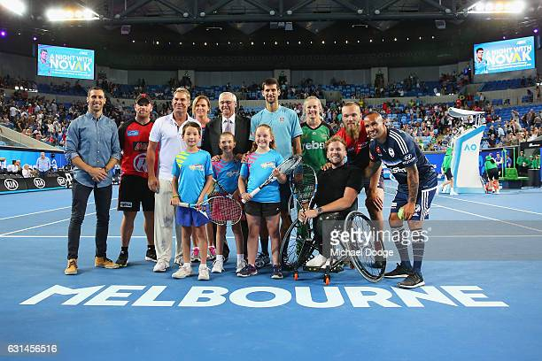 Novak Djokovic of Serbia poses with ANZ Hotshot tennis kids and current and past Australian sporting icons Aaron Finch of the Melbourne Stars former...