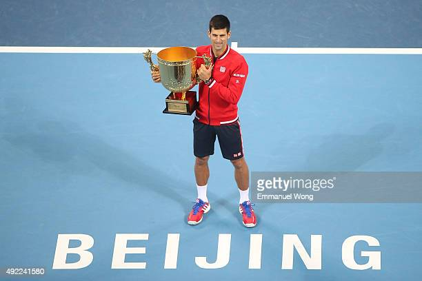 Novak Djokovic of Serbia poses with his trophy after winning the Men's single final match against Rafael Nadal of Spain on day 9 of the 2015 China...