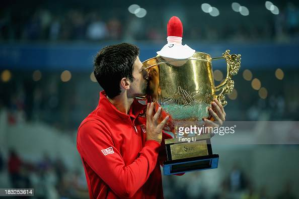 Novak Djokovic of Serbia poses with his trophy during the medal ceremony after winning the Men's Single Final of the China Open at the China National...