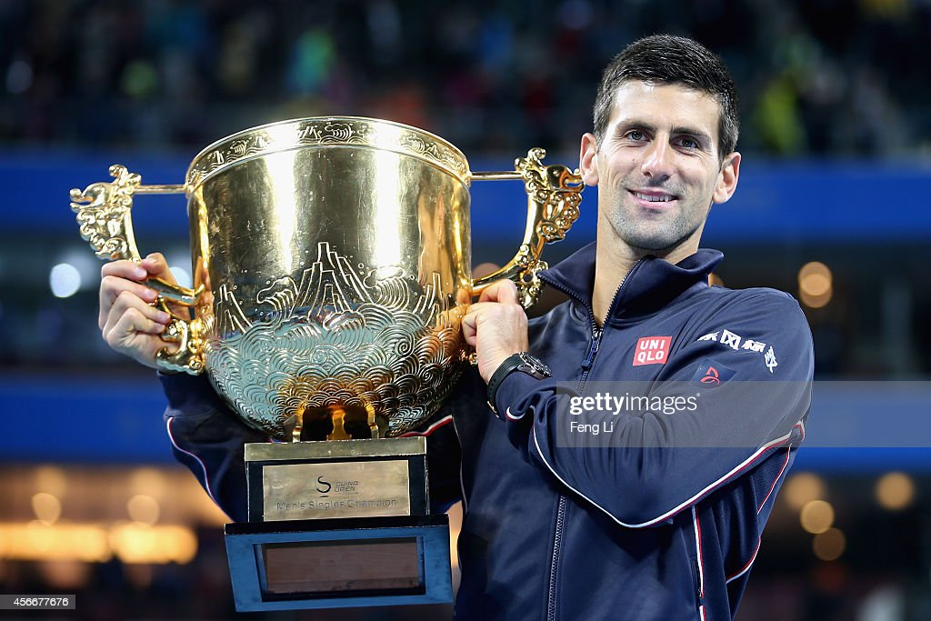 Novak Djokovic of Serbia poses with his trophy during the medal ceremony after the Men's Single Final on day nine of the China Open at the China National Tennis Center on October 5, 2014 in Beijing, China.