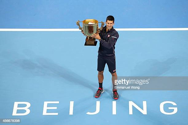 Novak Djokovic of Serbia poses with his trophy during the medal ceremony after the Men's Single Final on day nine of the China Open at the China...
