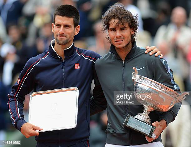 Novak Djokovic of Serbia poses with Rafael Nadal of Spain after the men's singles final during day 16 of the French Open at Roland Garros on June 11...