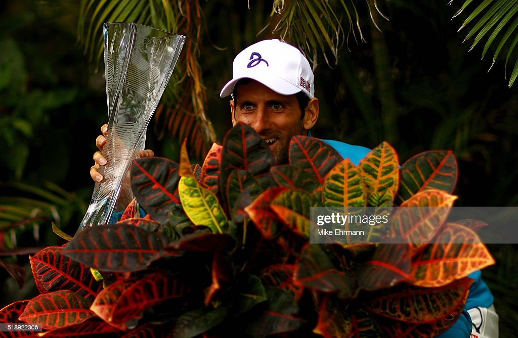 Novak Djokovic of Serbia poses with the Butch Buchholz Trophy after winning the Men's Final against Kei Nishikori of Japan during Day 14 of the Miami Open presented by Itau at Crandon Park Tennis Center on April 3, 2016 in Key Biscayne, Florida.