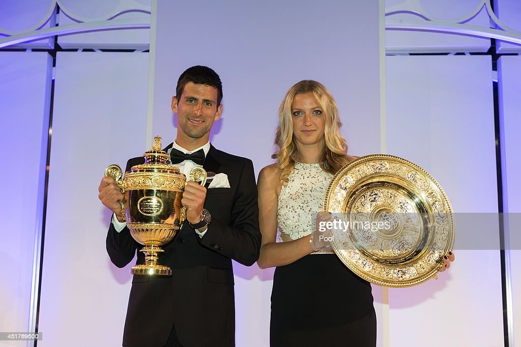<a gi-track='captionPersonalityLinkClicked' href=/galleries/search?phrase=Novak+Djokovic&family=editorial&specificpeople=588315 ng-click='$event.stopPropagation()'>Novak Djokovic</a> of Serbia poses with the Gentlemen's Singles Trophy and Petra Kvitova of the Czech Republic poses with the Venus Rosewater Dish trophy at the Wimbledon Championships 2014 Winners Ball at The Royal Opera House on July 6, 2014 in London, England.