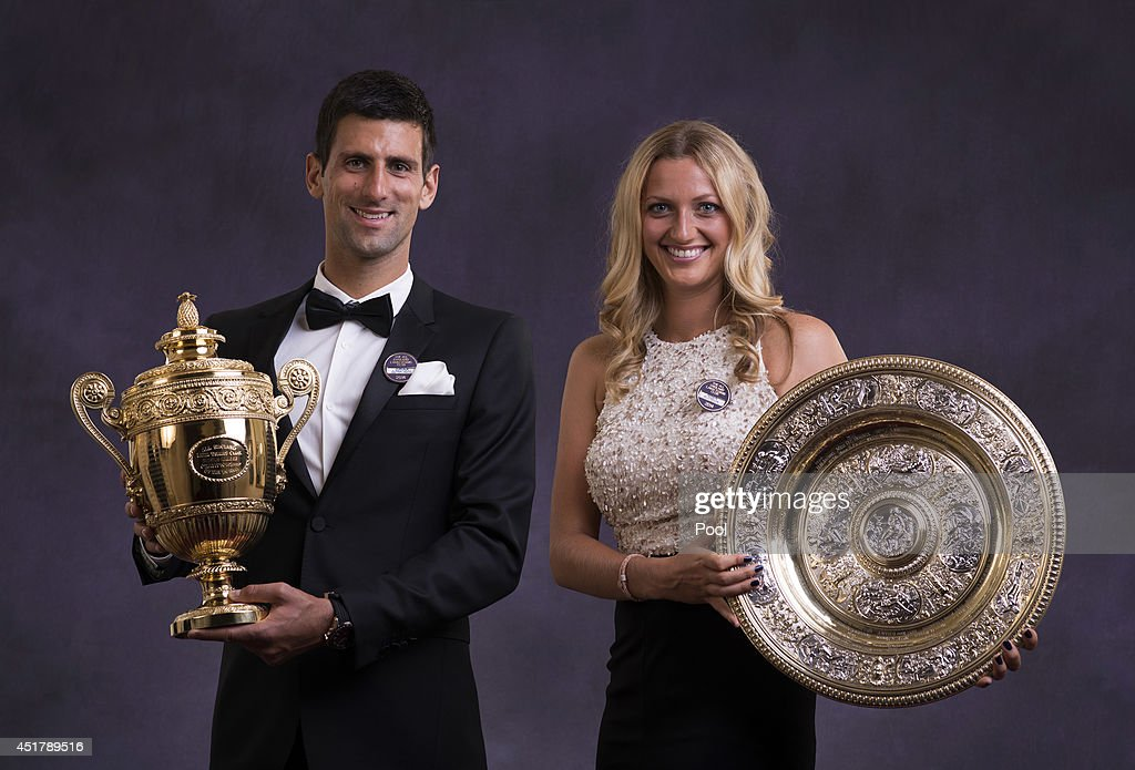 Novak Djokovic of Serbia poses with the Gentlemen's Singles Trophy and Petra Kvitova of the Czech Republic poses with the Venus Rosewater Dish trophy at the Wimbledon Championships 2014 Winners Ball at The Royal Opera House on July 6, 2014 in London, England.