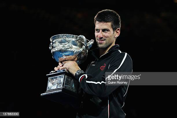 Novak Djokovic of Serbia poses with the Norman Brookes Challenge Cup after winning the men's final match against Rafael Nadal of Spain during day...