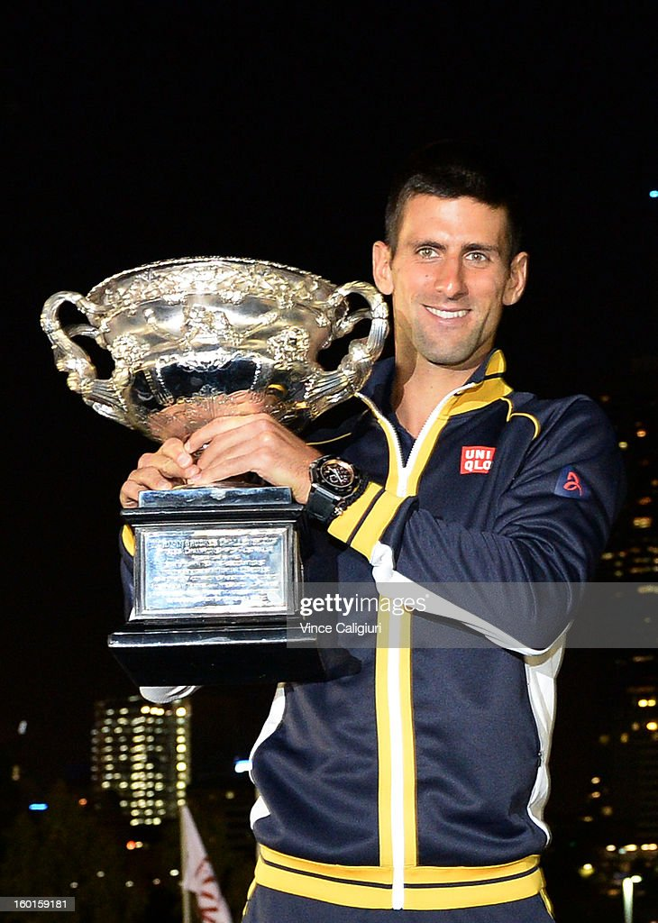 <a gi-track='captionPersonalityLinkClicked' href=/galleries/search?phrase=Novak+Djokovic&family=editorial&specificpeople=588315 ng-click='$event.stopPropagation()'>Novak Djokovic</a> of Serbia poses with the Norman Brookes Challenge Cup in the early hours of January 28, 2013 after winning his men's final match against Andy Murray of Great Britain during day fourteen of the 2013 Australian Open at Melbourne Park on January 27, 2013 in Melbourne, Australia.