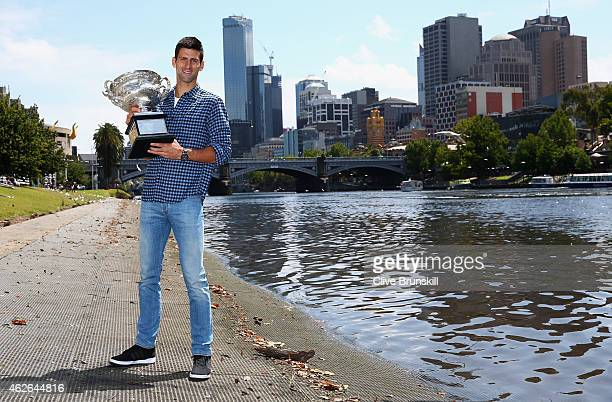 Novak Djokovic of Serbia poses with the Norman Brookes Challenge Cup at the Melbourne University Boat Club after winning the 2015 Australian Open on...
