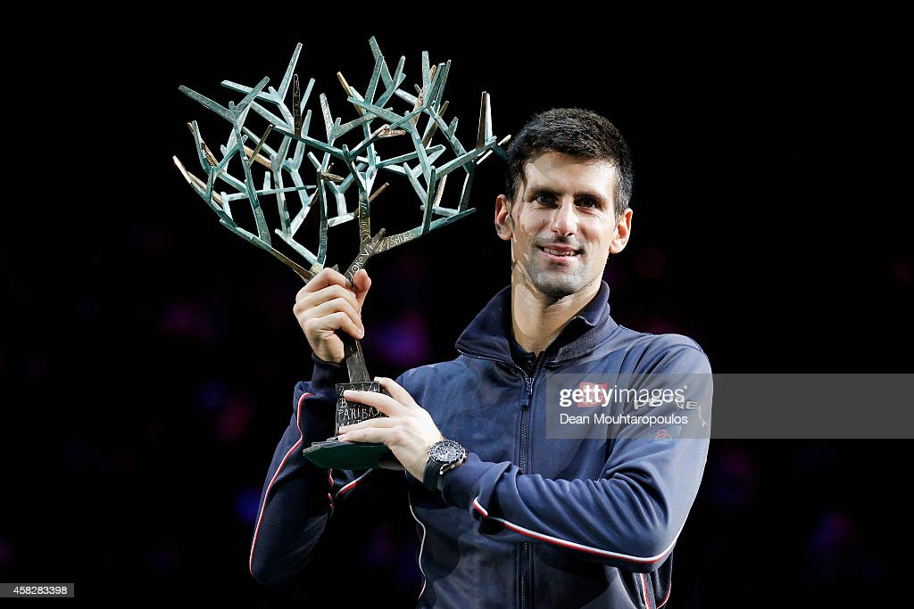 Novak Djokovic of Serbia poses with the trophy after victory against Milos Raonic of Canada in their Final during day 7 of the BNP Paribas Masters held at the at Palais Omnisports de Bercy on November 2, 2014 in Paris, France.