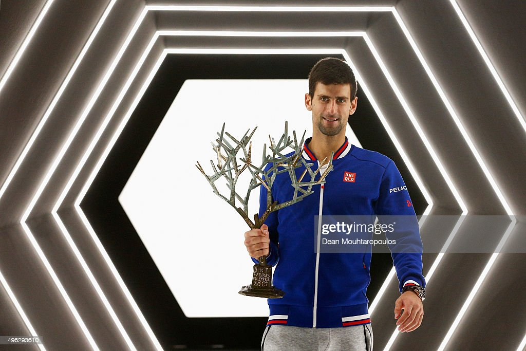 <a gi-track='captionPersonalityLinkClicked' href=/galleries/search?phrase=Novak+Djokovic&family=editorial&specificpeople=588315 ng-click='$event.stopPropagation()'>Novak Djokovic</a> of Serbia poses with the trophy after victory against Andy Murray of Great Britain in their Mens Final match during Day 7 of the BNP Paribas Masters held at AccorHotels Arena on November 8, 2015 in Paris, France.