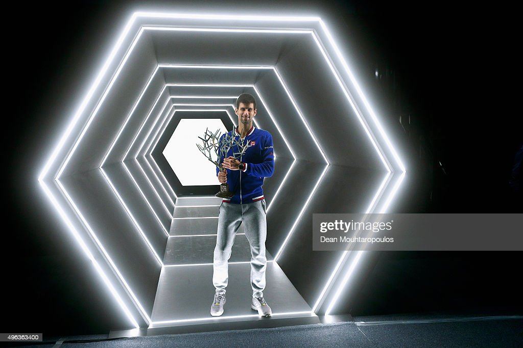 Novak Djokovic of Serbia poses with the trophy after victory against Andy Murray of Great Britain in their Mens Final match during Day 7 of the BNP Paribas Masters held at AccorHotels Arena on November 8, 2015 in Paris, France.