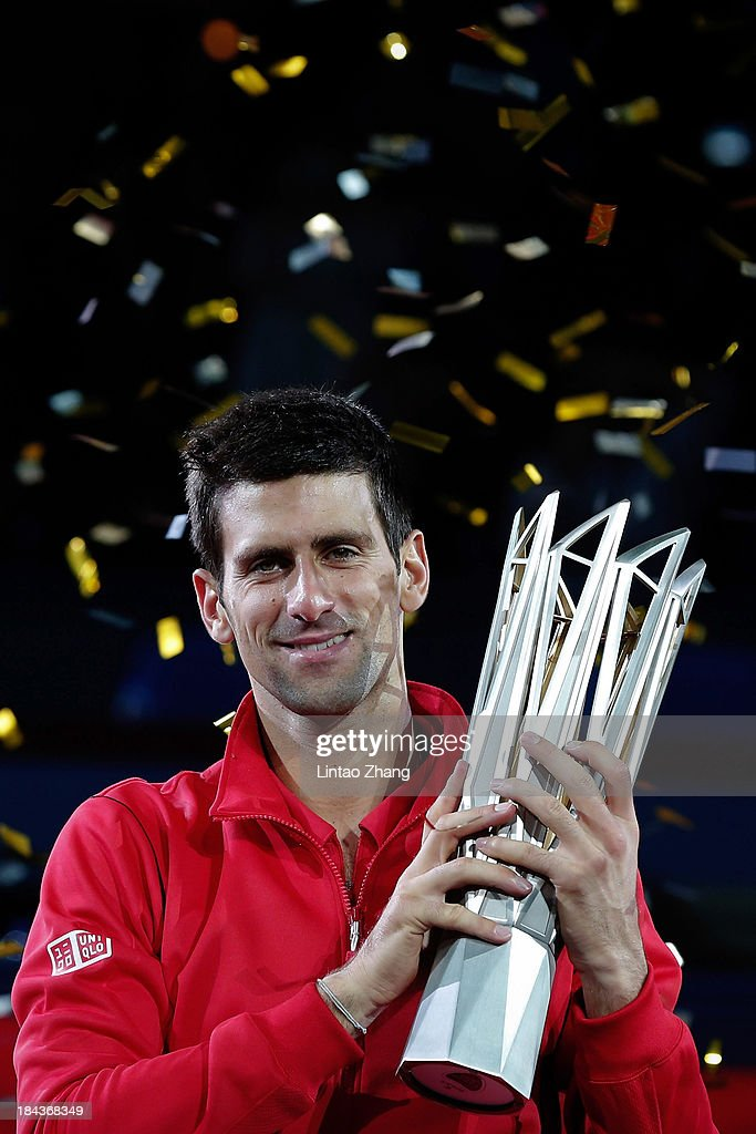 <a gi-track='captionPersonalityLinkClicked' href=/galleries/search?phrase=Novak+Djokovic&family=editorial&specificpeople=588315 ng-click='$event.stopPropagation()'>Novak Djokovic</a> of Serbia poses with the winner's trophy after defeating Juan Martin Del Potro of Argentina during day seven of the Shanghai Rolex Masters at the Qi Zhong Tennis Center on October 13, 2013 in Shanghai, China.