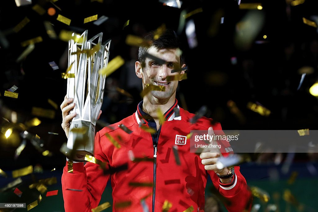 Novak Djokovic of Serbia poses with the winner's trophy after defeating Jo-Wilfried Tsonga of France during the men's singles final match of the Shanghai Rolex Masters at the Qi Zhong Tennis Center on day 8 of Shanghai Rolex Masters at Qi Zhong Tennis Centre on October 18, 2015 in Shanghai, China.