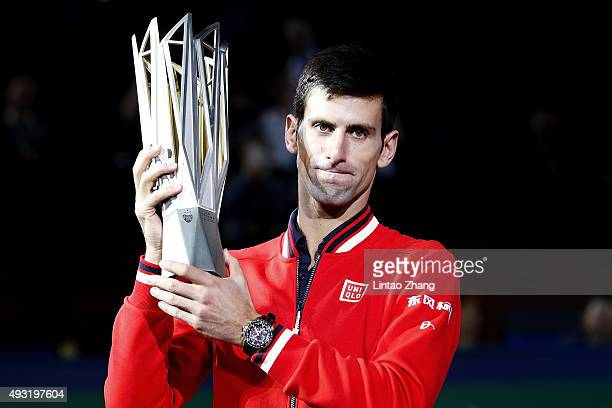 Novak Djokovic of Serbia poses with the winner's trophy after defeating JoWilfried Tsonga of France during the men's singles final match of the...