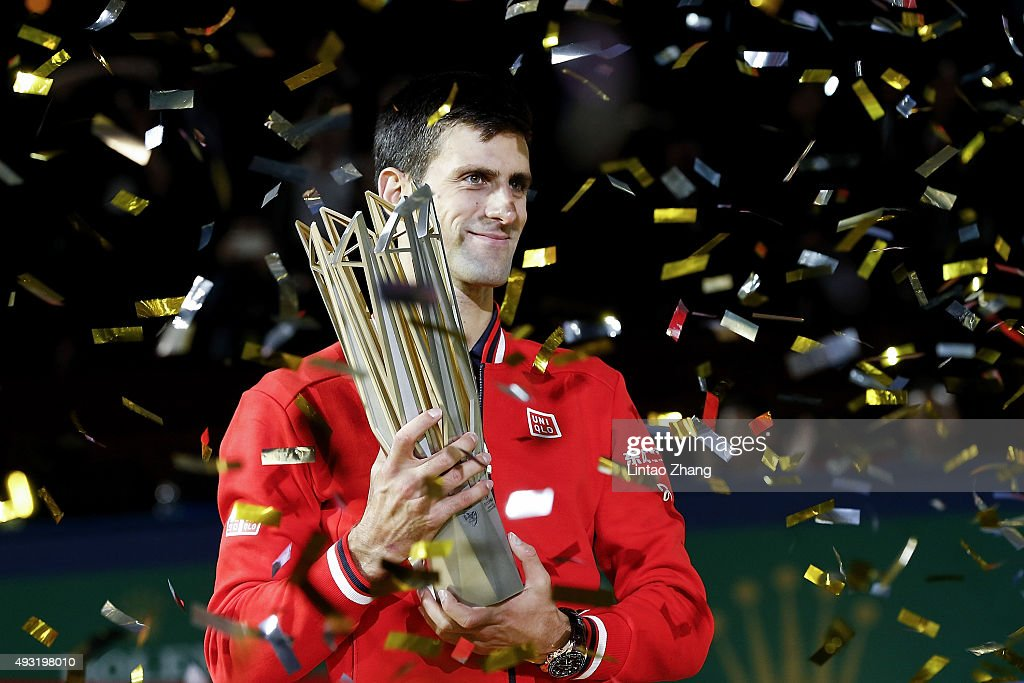 <a gi-track='captionPersonalityLinkClicked' href=/galleries/search?phrase=Novak+Djokovic&family=editorial&specificpeople=588315 ng-click='$event.stopPropagation()'>Novak Djokovic</a> of Serbia poses with the winner's trophy after defeating Jo-Wilfried Tsonga of France during the men's singles final match of the Shanghai Rolex Masters at the Qi Zhong Tennis Center on day 8 of Shanghai Rolex Masters at Qi Zhong Tennis Centre on October 18, 2015 in Shanghai, China.