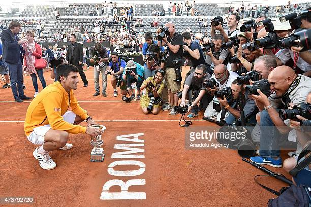 Novak Djokovic of Serbia poses with trophy after defeating Roger Federer of Switzerland in their men's singles final match at The Internazionali BNL...