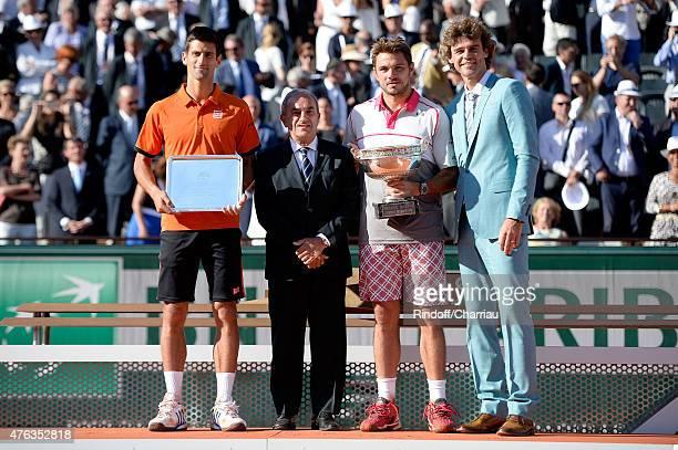 Novak Djokovic of Serbia President of the French Tennis Federation Jean Gachassin Stanislas Wawrinka of Switzerland and Gustavo Kuerten pose on stage...