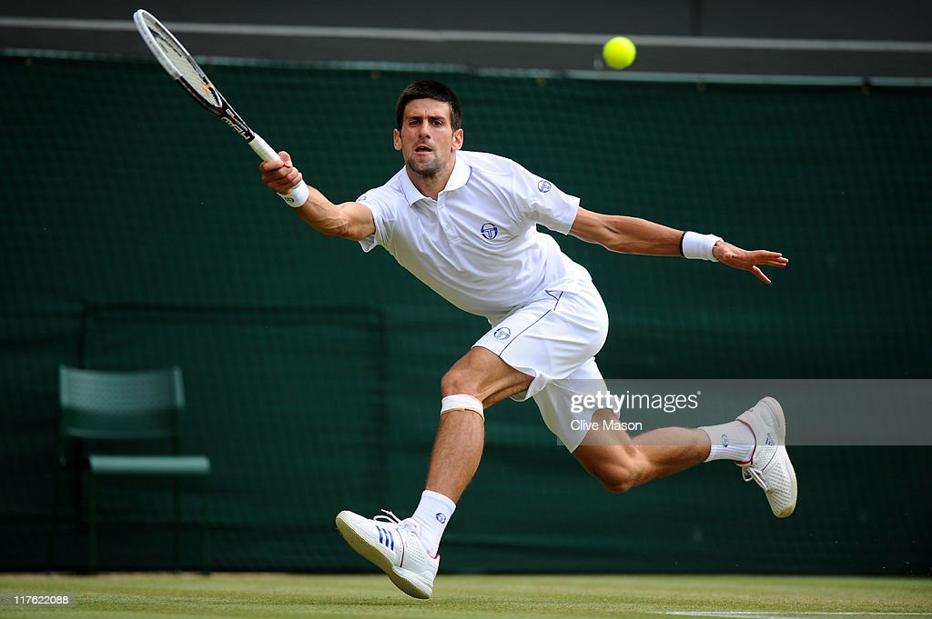 Novak Djokovic of Serbia reaches for a shot during his quarterfinal round match against Bernard Tomic of Australia on Day Nine of the Wimbledon Lawn Tennis Championships at the All England Lawn Tennis and Croquet Club on June 29, 2011 in London, England.