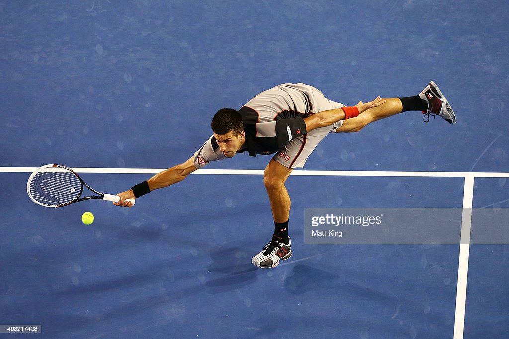 <a gi-track='captionPersonalityLinkClicked' href=/galleries/search?phrase=Novak+Djokovic&family=editorial&specificpeople=588315 ng-click='$event.stopPropagation()'>Novak Djokovic</a> of Serbia reaches out to play a forehand volley in his third round match against Denis Istomin of Uzbekistan during day five of the 2014 Australian Open at Melbourne Park on January 17, 2014 in Melbourne, Australia.