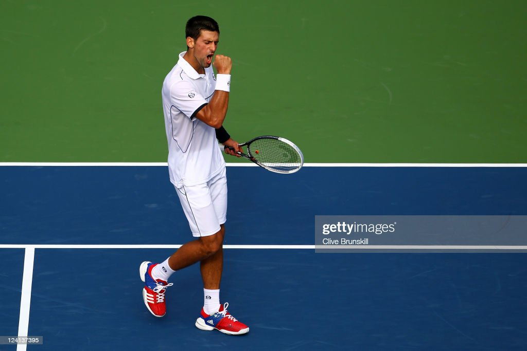 <a gi-track='captionPersonalityLinkClicked' href=/galleries/search?phrase=Novak+Djokovic&family=editorial&specificpeople=588315 ng-click='$event.stopPropagation()'>Novak Djokovic</a> of Serbia reacts after a point against Janko Tipsarevic of Serbia during Day Eleven of the 2011 US Open at the USTA Billie Jean King National Tennis Center on September 8, 2011 in the Flushing neighborhood of the Queens borough of New York City.