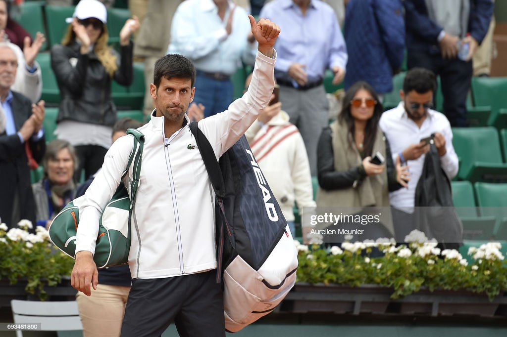 Novak Djokovic of Serbia reacts after loosing the men's singles quarterfinal match against Dominic Thiem of Austria on day eleven of the 2017 French Open at Roland Garros on June 7, 2017 in Paris, France.