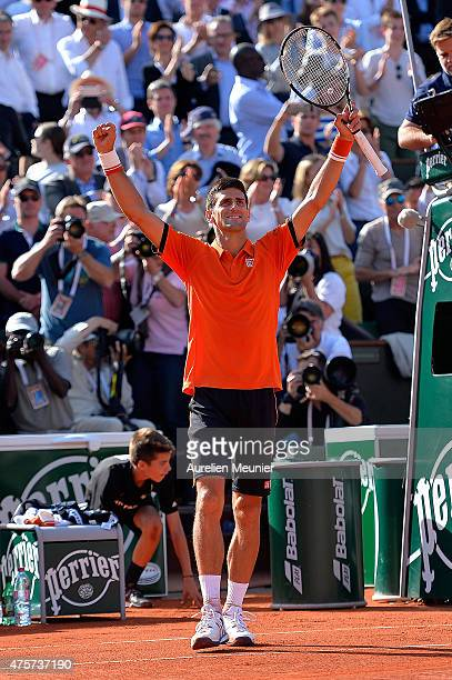 Novak Djokovic of Serbia reacts after winning his Men's quarter final match against Rafael Nadal of Spain on day eleven of the 2015 French Open at...
