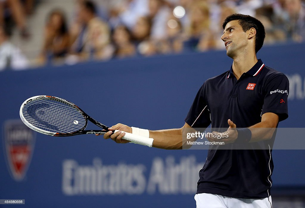 <a gi-track='captionPersonalityLinkClicked' href=/galleries/search?phrase=Novak+Djokovic&family=editorial&specificpeople=588315 ng-click='$event.stopPropagation()'>Novak Djokovic</a> of Serbia reacts against Andy Murray of Great Britain during their men's singles quarterfinal match on Day Ten of the 2014 US Open at the USTA Billie Jean King National Tennis Center on September 3, 2014 in the Flushing neighborhood of the Queens borough of New York City.