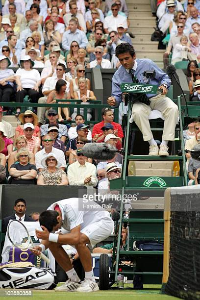 Novak Djokovic of Serbia reacts as he speaks to the Chair Umpire after a line call during the Men�s Semi Final match against Tomas Berdych of Czech...