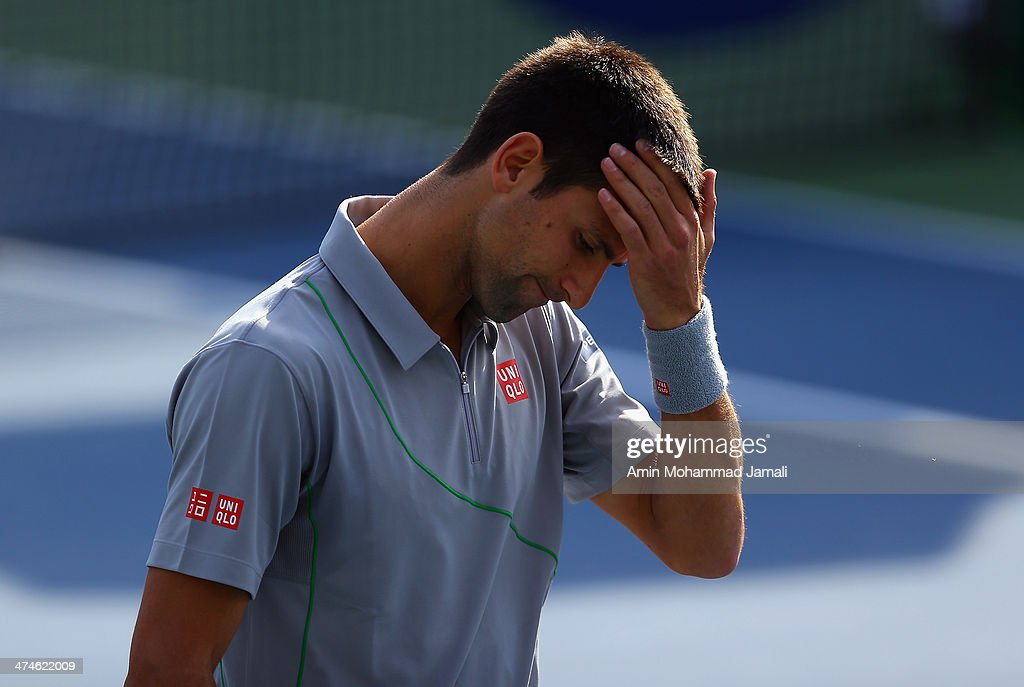 Novak Djokovic of Serbia reacts during his doubles match with Carlos Gomez- Herrera of Spain against Tomasz Bednarek of Poland and Lukas Dlouhy of Czech Republic during the ATP Dubai Duty Free Tennis Championship on February 24, 2014 in Dubai, United Arab Emirates.