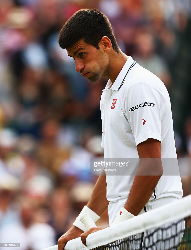 <a gi-track='captionPersonalityLinkClicked' href=/galleries/search?phrase=Novak+Djokovic&family=editorial&specificpeople=588315 ng-click='$event.stopPropagation()'>Novak Djokovic</a> of Serbia reacts during his Gentlemen's Singles quarter-final match against <a gi-track='captionPersonalityLinkClicked' href=/galleries/search?phrase=Marin+Cilic&family=editorial&specificpeople=553788 ng-click='$event.stopPropagation()'>Marin Cilic</a> of Croatia on day nine of the Wimbledon Lawn Tennis Championships at the All England Lawn Tennis and Croquet Club at Wimbledon on July 2, 2014 in London, England.