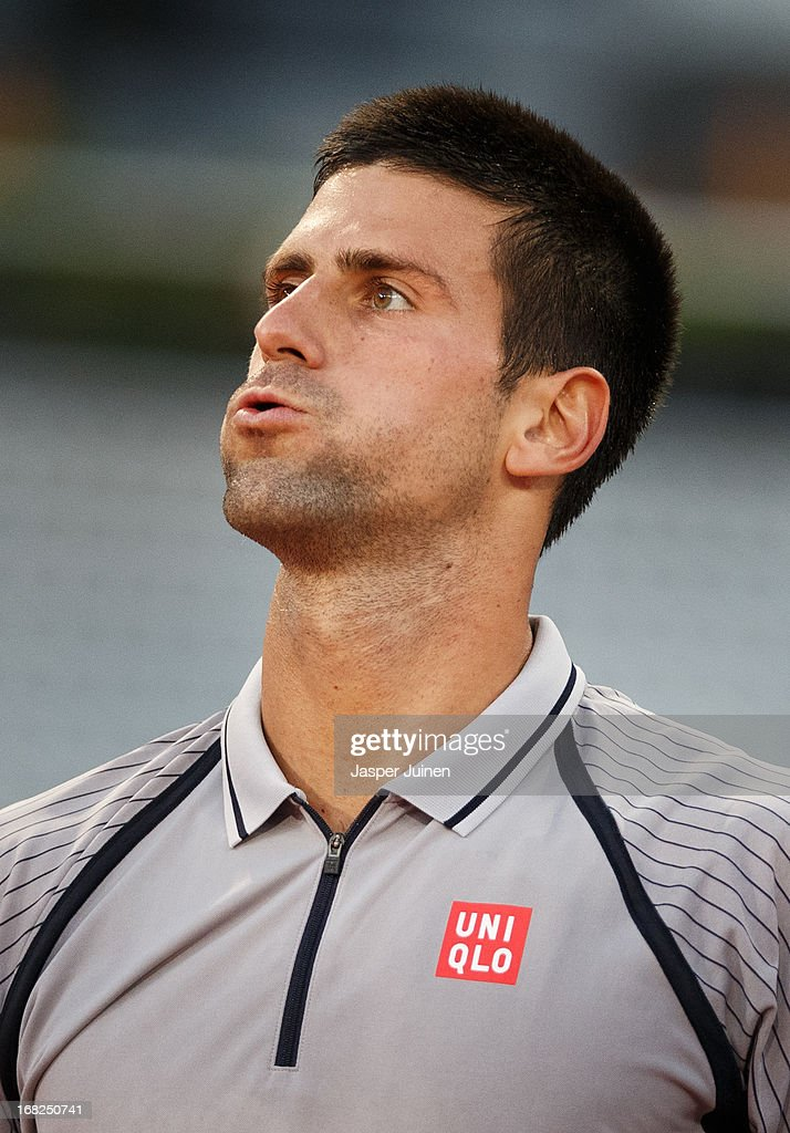 <a gi-track='captionPersonalityLinkClicked' href=/galleries/search?phrase=Novak+Djokovic&family=editorial&specificpeople=588315 ng-click='$event.stopPropagation()'>Novak Djokovic</a> of Serbia reacts during his match against Grigor Dimitrov of Bulgaria on day four of the Mutua Madrid Open tennis tournament at the Caja Magica on May 7, 2013 in Madrid, Spain.