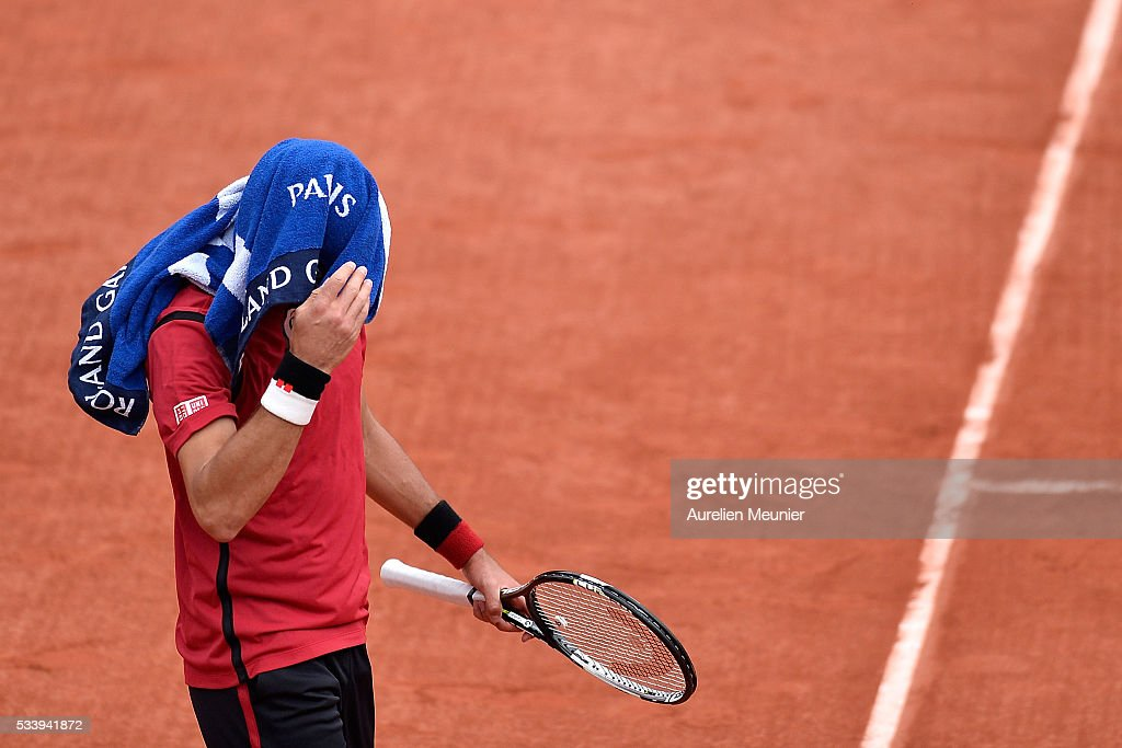 <a gi-track='captionPersonalityLinkClicked' href=/galleries/search?phrase=Novak+Djokovic&family=editorial&specificpeople=588315 ng-click='$event.stopPropagation()'>Novak Djokovic</a> of Serbia reacts during his men's single first round match against Yen-Hsun Lu of Chinese Tapei at Roland Garros on May 24, 2016 in Paris, France.