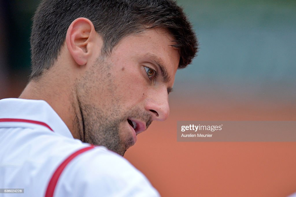Novak Djokovic of Serbia reacts during his men's singles fourth round match against Roberto Bautista Agut of Spain on day ten of the 2016 French Open at Roland Garros on May 31, 2016 in Paris, France.