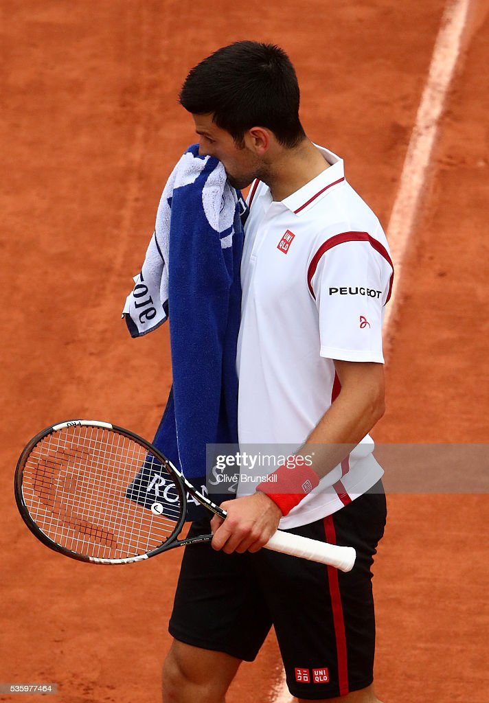 <a gi-track='captionPersonalityLinkClicked' href=/galleries/search?phrase=Novak+Djokovic&family=editorial&specificpeople=588315 ng-click='$event.stopPropagation()'>Novak Djokovic</a> of Serbia reacts during the Men's Singles fourth round match against Roberto Bautista Agut of Spain on day ten of the 2016 French Open at Roland Garros on May 31, 2016 in Paris, France.