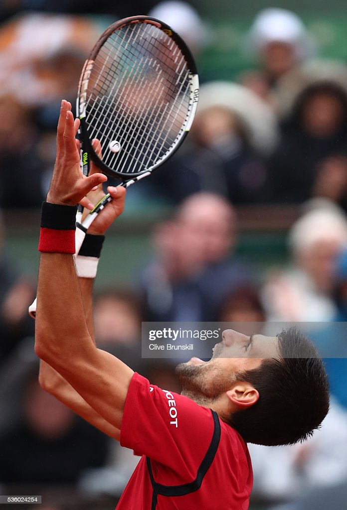 Novak Djokovic of Serbia reacts during the Men's Singles fourth round match against Roberto Bautista Agut of Spain on day ten of the 2016 French Open at Roland Garros on May 31, 2016 in Paris, France.