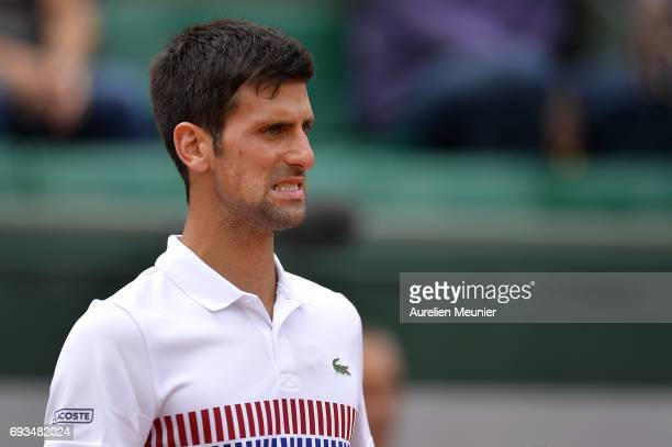 Novak Djokovic of Serbia reacts during the men's singles quarterfinal match against Dominic Thiem of Austria on day eleven of the 2017 French Open at...
