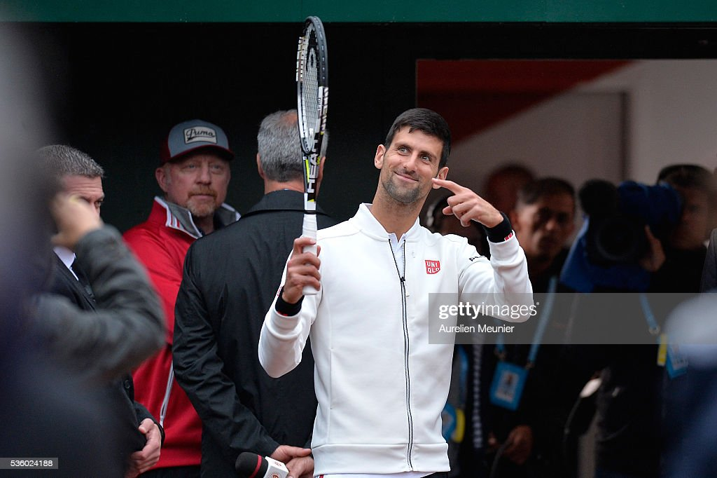 Novak Djokovic of Serbia reacts during the rain break during his men's singles fourth round match against Roberto Bautista Agut of Spain on day ten of the 2016 French Open at Roland Garros on May 31, 2016 in Paris, France.