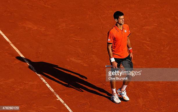 Novak Djokovic of Serbia reacts in the Men's Singles Final against Stanislas Wawrinka of Switzerland on day fifteen of the 2015 French Open at Roland...