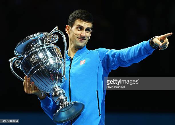 Novak Djokovic of Serbia receives the ATP World Number 1 Award after his match against Kei Nishikori of Japan during day one of the Barclays ATP...