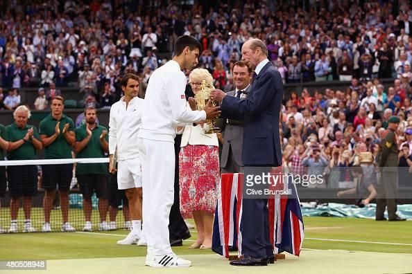 Novak Djokovic of Serbia receives the trophy from Prince Edward Duke of Kent after winning the Final Of The Gentlemen's Singles against Roger Federer...