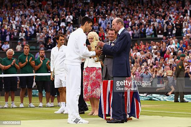 Novak Djokovic of Serbia receives the trophy from Prince Edward Duke of Kent after winning the Final Of The Gentlemen's Singles against Roger Federer...