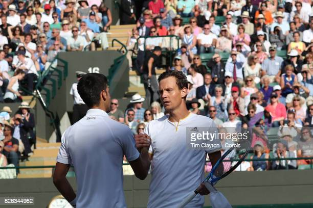 Novak Djokovic of Serbia retires injured during his match against Tomas Berdych of the Czech Republic in the Mens' Singles Quarter Final match on...