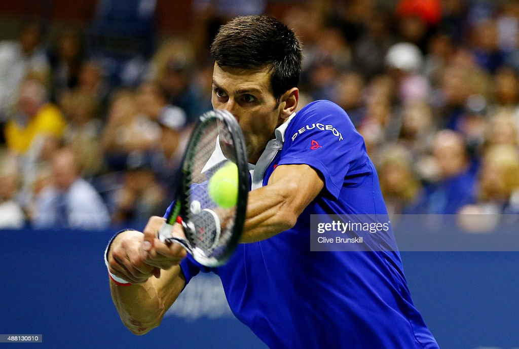 Novak Djokovic of Serbia returns a backhand shot to Roger Federer of Switzerland during their Men's Singles Final match on Day Fourteen of the 2015...