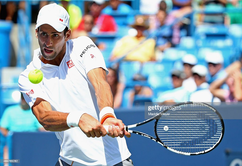 Novak Djokovic of Serbia returns a backhand to Stanislas Wawrinka of Switzerland during their quarterfinal match on Day 7 of the Western Southern...
